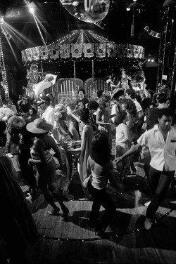 Dancers in front of the merry-go-round at Electric Circus