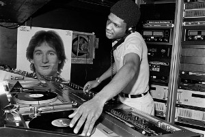 Larry Levan behind the turntables at Paradise Garage