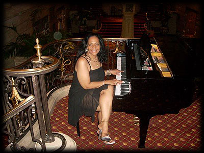 Donna McGhee playing the piano