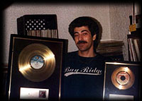 Pooch with Gold Records for Sylvester and Patrick Hernandez